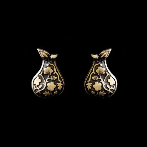 Oorbellen Grushevi Seta een uniek sieraad in de kleur brons. In combinatie met de ketting en armband heeft u een unieke set sieraden | sieradencorner.nl
