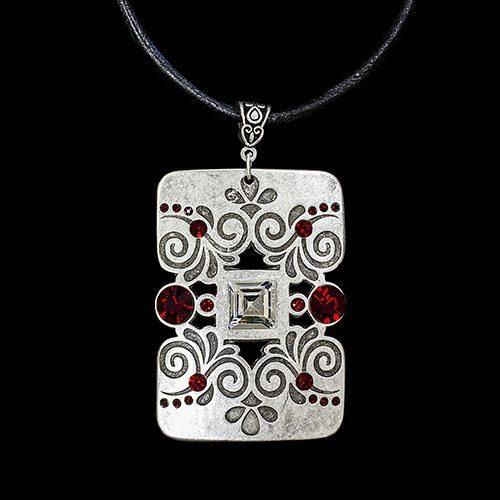 Ketting Elekra een uniek sieraad. Zwart leren ketting met uniek bewerkte hanger versierd met rode steentjes. Exclusieve sieraden bij sieradencorner.nl. SALE € 10,00